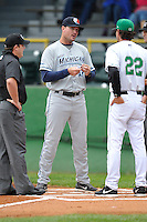 Manager Andrew Graham #17 of the West Michigan Whitecaps meets at home plate priror to the game against the Clinton LumberKings at Ashford University Field on July  25, 2014 in Clinton, Iowa. The Whitecaps won 9-0.   (Dennis Hubbard/Four Seam Images)