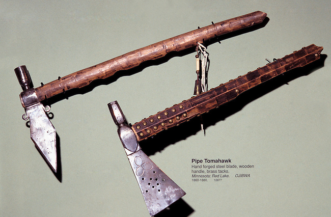 Ojibwa (Chippewa) tomahawk pipes with steel blades and wooden stems used for trade, as a tool, warclub and peace pipe