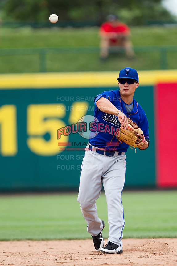Thomas Field (2) of the Tulsa Drillers throws to first during a game against the Springfield Cardinals at Hammons Field on June 27, 2011 in Springfield, Missouri. (David Welker / Four Seam Images)