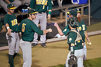 Siena Saints starting pitcher Tom Miller (42) fist bumps Ryan Stefaniak (15) during a game against the Stetson Hatters on February 23, 2016 at Melching Field at Conrad Park in DeLand, Florida.  Stetson defeated Siena 5-3.  (Mike Janes/Four Seam Images)