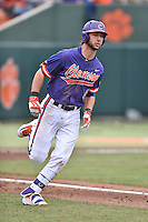 Clemson Tigers second baseman Weston Wilson (8) runs to first base during a game against the Maine Black Bears at Doug Kingsmore Stadium on February 20, 2016 in Clemson, South Carolina. The Tigers defeated the Black Bears 9-4. (Tony Farlow/Four Seam Images)