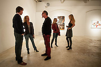 Art enthusiasts take in the works of Marcus Jansen and sculpturist Jonas Stirner at the 7,000-square-foot studio/gallery Unit A Contemporary Art Space during Art Walk in Downtown Fort Myers River District, Fort Myers, Florida, USA, March 1, 2013. Photo by Debi Pittman Wilkey