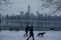 People walk by the Hudson River shore in Jersey City , as winter storm hits the tri-state area causing significant delays at airports in the region. Last month was coldest February in New York City since 1869. Mar 01,2015. Eduardo Munoz/VIEWpress.