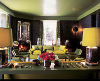 The green living room of Ken Scott's Mexican residence in Cuernavaca, Mexico. Built in the 1970s it reflects Scott's lifetime of fashion design experience using bold, engaging colour schemes