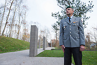 """Auf dem Gelaende des Einsatzfuehrungskommando der Bundeswehr, der Henning-von-Tresckow-Kaserne bei Potsdam, wurde ein Ehrenhain zum Gedenken an die im Einsatz verstorbenen Bundeswehrangehoerigen eingerichtet. In diesem """"Wald der Erinnerunge"""" sind die Gedenkhaine aus den Einsatzgebieten der Bundeswehr errichtet worden. Zum Teil originalgetreu nachgebildet von den Orten in denen die Bundeswehr eingesetzt war und Angehoerige verstorben sind.<br /> Im Bild: Oberstleutnant T. Kolatzki im Ehrenhain.<br /> 14.11.2014, Potsdam<br /> Copyright: Christian-Ditsch.de<br /> [Inhaltsveraendernde Manipulation des Fotos nur nach ausdruecklicher Genehmigung des Fotografen. Vereinbarungen ueber Abtretung von Persoenlichkeitsrechten/Model Release der abgebildeten Person/Personen liegen nicht vor. NO MODEL RELEASE! Don't publish without copyright Christian-Ditsch.de, Veroeffentlichung nur mit Fotografennennung, sowie gegen Honorar, MwSt. und Beleg. Konto: I N G - D i B a, IBAN DE58500105175400192269, BIC INGDDEFFXXX, Kontakt: post@christian-ditsch.de<br /> Urhebervermerk wird gemaess Paragraph 13 UHG verlangt.]"""