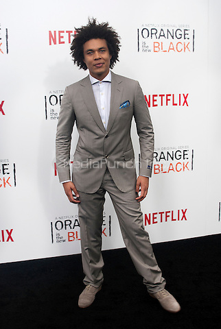 NEW YORK, NEW YORK - MAY 15, 2014:  Actor Ismael Cruz Córdova attends the Season 2 Premiere of 'Orange is the New Black' hosted by Netflix at The Ziegfeld Theater in New York, New York on Thursday May 15, 2014. Photo credit:RTNHargrove/MediaPunch