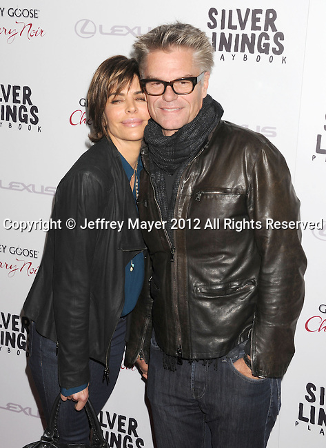 BEVERLY HILLS, CA - NOVEMBER 19: Lisa Rinna and Harry Hamlin arrive at the 'Silver Linings Playbook' - Los Angeles Special Screening at the Academy of Motion Picture Arts and Sciences on November 19, 2012 in Beverly Hills, California.