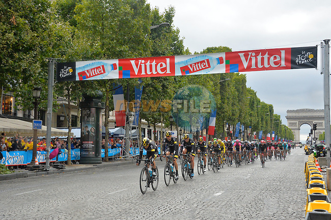 Team Sky lead the peloton over the finish line on the Champs Elysees in Paris during Stage 21 of the 2015 Tour de France running 109.5km from Sevres to Paris - Champs Elysees, France. 26th July 2015.<br /> Photo: ASO/B.Bade/Newsfile