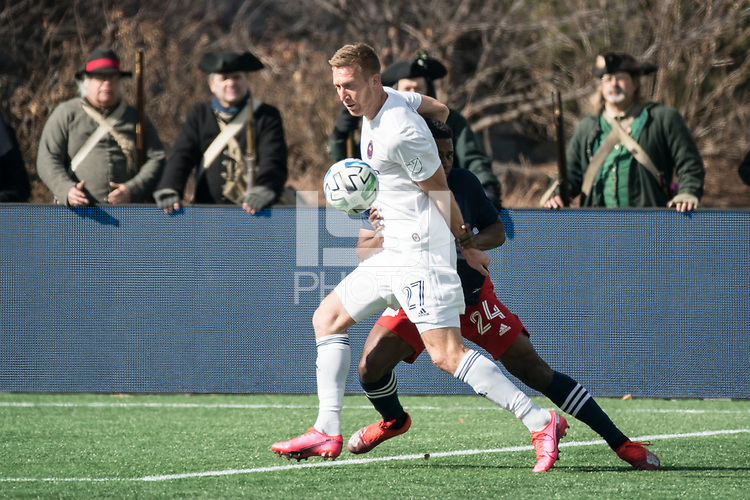 FOXBOROUGH, MA - MARCH 7: Robert Beric #27 of Chicago Fire and DeJuan Jones #24 of New England Revolution battle for the ball during a game between Chicago Fire and New England Revolution at Gillette Stadium on March 7, 2020 in Foxborough, Massachusetts.