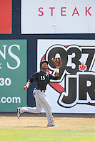 Kevonte Mitchell (15) of the Eugene Emeralds catches a fly ball during a game against the Vancouver Canadians at Nat Bailey Stadium on July 22, 2015 in Vancouver, British Columbia. Vancouver defeated Eugene, 4-2. (Larry Goren/Four Seam Images)