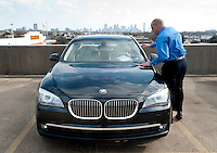 Client Advisor for BMW Robert Moses (cq), checks out a new car at the BMW of Dallas, an AutoMotion Company, car dealership in Dallas, Texas, Thursday, February 17, 2011. Auto sales are going up because financing for auto loans has become available again...Photo by Matt Nager