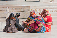 Agra, India.  Taj Mahal.  Indian Women Wearing Saris Sitting and Talking.  Note the ankle bracelet.