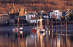 Winter atmospheric low tide on the River Dee at Kirkcudbright turning of the tides creating calm waters and reflections on town and boats in the water Galloway Scotland UK