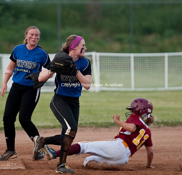 STRATFORD, CT--061215JS07-   Oxford's Meghan Sastram (23) gets St. Joseph's Hanna Errico (12) out on a force play but can't turn the double play during their Class M state championship game Friday at DeLuca Field in Stratford. <br /> Jim Shannon Republican-American