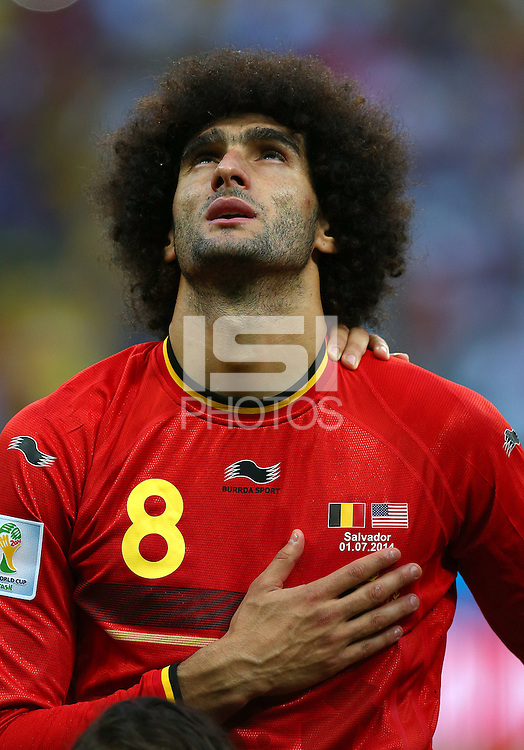 Marouane Fellaini of Belgium looks to the sky as he sings his national anthem