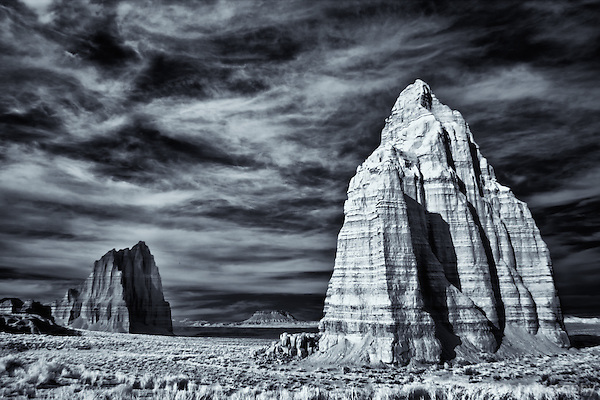 Temple of the Sun and Temple of the Moon rock formations captured in Utah's Cathedral Valley using an infrared camera.