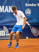 September 03, 2014,Netherlands, Alphen aan den Rijn, TEAN International, Robin Haase (NED) hits the ball behind his back<br /> Photo: Tennisimages/Henk Koster