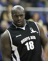Adebayo Akinfenwa of AFC Wimbledon during Hoops Aid 2015 Celebrity AllStars Basketball Match at the o2 Arena, London, England on 10 May 2015. Photo by Andy Rowland.