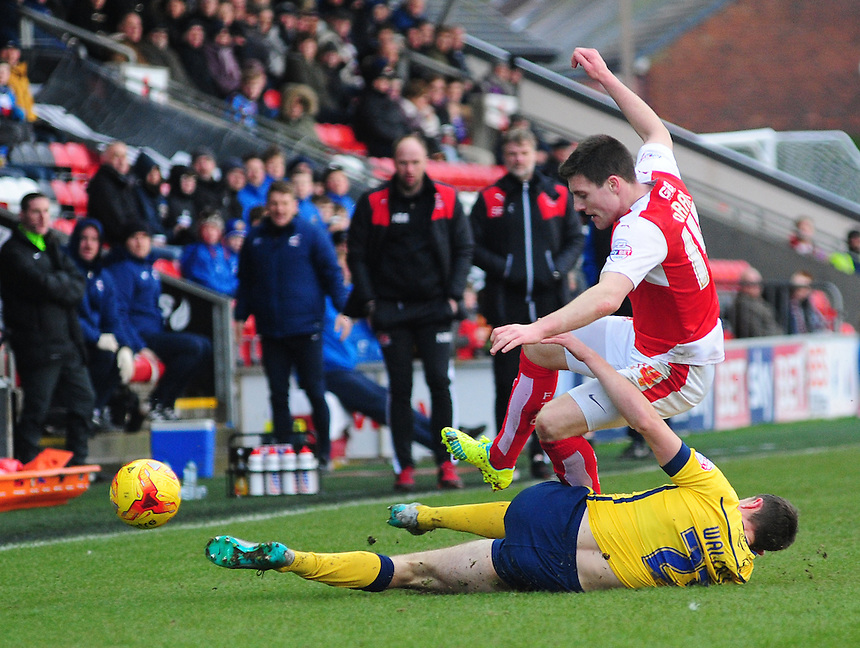 Fleetwood Town's Bobby Grant is tackled by Scunthorpe United&rsquo;s Murray Wallace<br /> <br /> Photographer Chris Vaughan/CameraSport<br /> <br /> Football - The Football League Sky Bet League One - Fleetwood Town v Scunthorpe United  - Saturday 20th February 2016 - Highbury Stadium - Fleetwood    <br /> <br /> &copy; CameraSport - 43 Linden Ave. Countesthorpe. Leicester. England. LE8 5PG - Tel: +44 (0) 116 277 4147 - admin@camerasport.com - www.camerasport.com