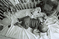 CAPE TOWN, SOUTH AFRICA - FEBRUARY 11: Baby Thsepang, one-years-old, lies in a hospital bed as she recovers from a brutal rape at the Red Cross Children?s Hospital February 11, 2002 in Cape Town, South Africa. The baby was brutally raped by her father in October 2001 in Loisevale, a poor black area outside Upington, located approximately 560 miles Northwest of Cape Town, South Africa. The country is struggling with an increasing number of rapes and sexual abuse of young children. In addition, the country has the highest number of rapes in the world. (Photo by Per-Anders Pettersson)