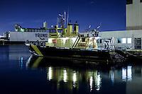 Boat in Honolulu Harbor at night, O'ahu
