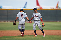AZL Indians Red infielders Jothson Flores (9) and Yordys Valdes (10) congratulate one another after turning a double play during an Arizona League game against the AZL Indians Blue on July 7, 2019 at the Cleveland Indians Spring Training Complex in Goodyear, Arizona. The AZL Indians Blue defeated the AZL Indians Red 5-4. (Zachary Lucy/Four Seam Images)