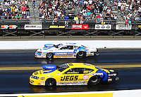 Jul. 28, 2013; Sonoma, CA, USA: NHRA pro stock driver Jeg Coughlin (near lane) races alongside Allen Johnson during the Sonoma Nationals at Sonoma Raceway. Mandatory Credit: Mark J. Rebilas-