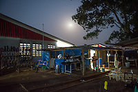 A nearly full moon shines over the ELWA II ETU (Ebola treatment unit) in Monrovia, Liberia on Wednesday, March 4, 2015. <br /> Occidental College professor Mary Beth Heffernan works on her PPE Portrait Project with health care workers at the ETU, which is staffed by over 120 people around the clock.<br /> (Photo by Marc Campos, Occidental College Photographer) Mary Beth Heffernan, professor of art and art history at Occidental College, works in Monrovia the capital of Liberia, Africa in 2015. Professor Heffernan was there to work on her PPE (personal protective equipment) Portrait Project, which helps health care workers and patients fighting the Ebola virus disease in West Africa.<br />