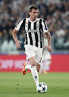 Football Soccer: UEFA Champions League Juventus vs Olympiacos Allianz Stadium. Turin, Italy, September 27, 2017. <br /> Juventus' Mario Mandzukic in action during the Uefa Champions League football soccer match between Juventus and Olympiacos at Allianz Stadium in Turin, September 27, 2017.<br /> UPDATE IMAGES PRESS/Isabella Bonotto
