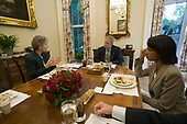 In this handout photo provided by the White House, United States President George W. Bush (C) meets with US Secretary of State Condoleezza Rice (R) and Karen Hughes (L), newly appointed undersecretary of state for public diplomacy, during lunch at the White House October 5, 2005 in Washington, DC. <br /> Mandatory Credit: Eric Draper / White House via CNP