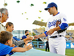 23 July 2011: Los Angeles Dodgers infielder Jamey Carroll signs autographs prior to to a game against the Washington Nationals at Dodger Stadium in Los Angeles, California. The Dodgers rallied to defeat the Nationals 7-6 on a Rafael Furcal walk-off, RBI double in the bottom of the 9th inning. Mandatory Credit: Ed Wolfstein Photo