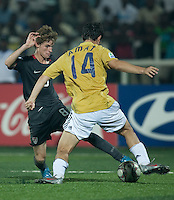 Alex Shinsky (8) against Jordi Amat (14). Spain defeated the U.S. Under-17 Men National Team  2-1 at Sani Abacha Stadium in Kano, Nigeria on October 26, 2009.
