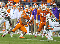 Charlotte, NC - December 2, 2017: Clemson Tigers running back Adam Choice (26) in action during the ACC championship game between Miami and Clemson at Bank of America Stadium in Charlotte, NC. Clemson defeated Miami 38-3 for their third consecutive championship title. (Photo by Elliott Brown/Media Images International)