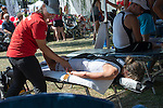 A triathlete get a well-deserved massage after a tough morning.