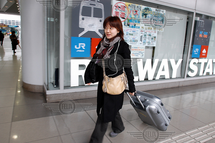 Passenger arrives at Kansai Airport from the adjoining JR railway station.