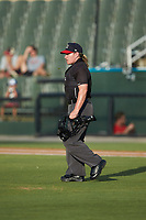 Home plate umpire Jennifer Pawol walks out to the mound during the South Atlantic League game between the Rome Braves and the Kannapolis Intimidators at Kannapolis Intimidators Stadium on July 2, 2019 in Kannapolis, North Carolina.  The Intimidators walked-off the Braves 5-4. (Brian Westerholt/Four Seam Images)