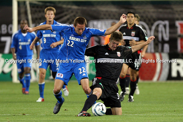 21 May 2005: Bobby Boswell (right) tries to keep the ball away from Davy Arnaud (22). DC United defeated the Kansas City Wizards 3-2 at RFK Stadium in Washington, DC in a regular season Major League Soccer game. . .