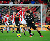 2nd December 2017, bet365 Stadium, Stoke-on-Trent, England; EPL Premier League football, Stoke City versus Swansea City; Ki Sung-Yueng of Swansea City looks for options to move the ball forward watched by Peter Crouch of Stoke City