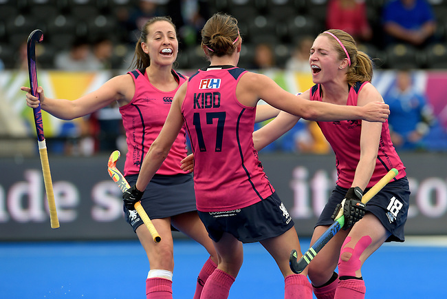 ENG - London, England, August 30: Nikki KIDD #17 of Scotland is congratulated by teammates after scoring the leading goal 1-0 during the women Pool C match between Scotland (pink) and Poland (white) on August 30, 2015 at Lee Valley Hockey and Tennis Centre, Queen Elizabeth Olympic Park in London, England. Final score 2-0 (1-0). (Photo by Dirk Markgraf / www.265-images.com) *** Local caption *** Nikki KIDD #17 of Scotland, Susan McGILVERAY #18 of Scotland