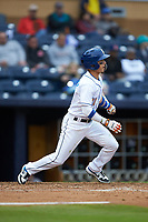 Andrew Velazquez (11) of the Durham Bulls follows through on his swing against the Gwinnett Braves at Durham Bulls Athletic Park on April 20, 2019 in Durham, North Carolina. The Bulls defeated the Braves 11-3 in game one of a double-header. (Brian Westerholt/Four Seam Images)