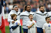 Guilhem Guirado, Mathieu Bastareaud and Rabah Slimani of France sing the national anthem. Natwest 6 Nations match between France and England on March 10, 2018 at the Stade de France in Paris, France. Photo by: Patrick Khachfe / Onside Images