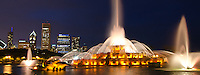 Buckingham Fountain at Night glows with the skyline of Chicago behind it, Chicago, Illinois