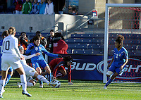 US forward Amy Rodriguez (8) scores the game's only goal on a sliding shot in front of Italian defender Laura Neboli (6) in the first half.  The U.S. Women's National Team defeated Italy 1-0 at Toyota Park in Bridgeview, IL on November 27, 2010 to advance to the Women's World Cup in Germany.