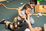 Education Preschool 4-5 year olds boy trying to stop physical conflict between boy and girl over possession of toy