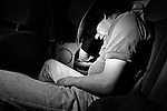 Jimmy 'Stretch' Borunda dozes off on the long ride home after a rodeo in Utopia, Texas. June 29, 2008.