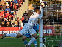 COLLEGE PARK, MD - NOVEMBER 03: Kevin Buca #19 of Michigan trues for a cross during a game between Michigan and Maryland at Ludwig Field on November 03, 2019 in College Park, Maryland.
