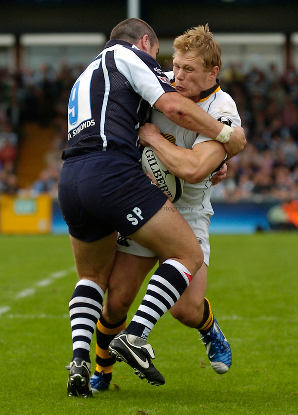 Photo: Richard Lane..Bristol Rugby v London Wasps. Guinness Premiership. 24/09/2006. .Wasps' Josh Lewsey is tackled by Shaun Perry.