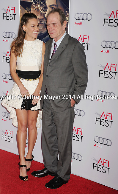 HOLLYWOOD, CA - NOVEMBER 11: Actress Hilary Swank (L) and actor/director Tommy Lee Jones attend the 'The Homesman' premiere during AFI FEST 2014 presented by Audi at the Dolby Theater on November 11, 2014 in Hollywood, California.
