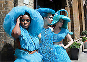 """Models wearing turquoise dresses by fashion designer Pierre Garroudi setting out on a flashmob in order to """"take over London""""."""
