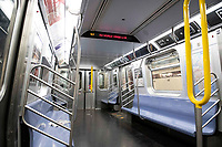 New York, New York City. New Yorkers are told to stay home during the corona virus, (COVID-19) so New York has become eerily empty. The subways are mostly devoid of people and the riders who use it are in face masks and gloves.
